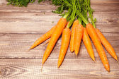 Carrot on a wooden table — Stockfoto
