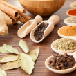 Stock Photo: Spice assortment on a wooden table
