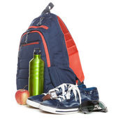 Backpack and sneakers on white background — Stock fotografie