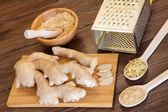 Cut, grated and ground ginger — Stock Photo