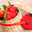 Stock Photo: Fresh strawberries in wicker basket