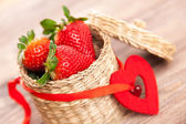 Fresh strawberries in a wicker basket — Stock Photo