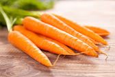 Carrot on a wooden table — Stock Photo
