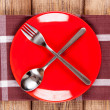 Red plate on a wooden table — Stock Photo #45295449