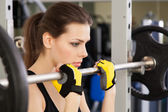 Slim young woman in a gym — Stock Photo