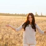 Beautiful lady in wheat field — Stock Photo #47176329
