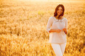 Beautiful lady in wheat field — Stock Photo