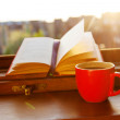 Books and a coffee cup — Stock Photo #48134997