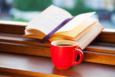 Books and a coffee cup — Stock Photo