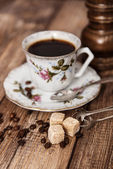 Vintage coffee cup on a wooden table — Stock Photo