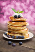 Delicious pancakes with blueberry and whipped cream — Stock Photo
