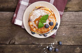 Delicious pancakes with blueberry and mint — Stok fotoğraf