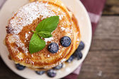 Delicious pancakes with blueberry and mint — Stock Photo