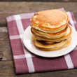 Delicious pancakes on a wooden table — Stock Photo