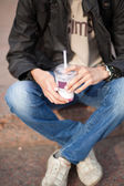 Young man drinking a milk shake — Stock Photo