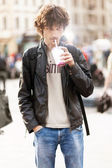 Young man drinking a milk shake — Stockfoto