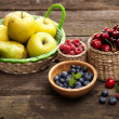 Fresh juicy apples, pears and berries on a wooden table — Stok fotoğraf