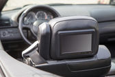 Multimedia screen in a luxury car — Stock Photo