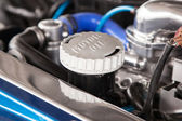 Motor oil cap under the hood of a car — Stock Photo