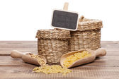 Pasta and buckwheat on a wooden table — Stock Photo