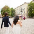 Young couple walking in old city — Stock Photo #50122651