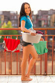 Young woman on her balcony — Stock Photo