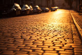 Paved road in an old european city — Stock Photo