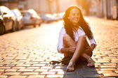 Young beautiful woman in an old city street — Stok fotoğraf