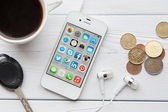 IPhone on a white wooden table — Stock Photo