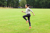 Young woman working out in a park — Stock Photo