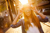 Young stylish woman in a city street — Stock Photo
