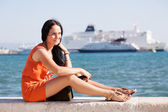 Young beautiful woman at the seaside — Stock Photo