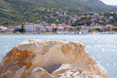 A rock on the beach in a resort town — Stock Photo
