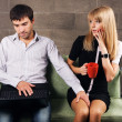 Young man and woman working with a laptop — Stock Photo #5725906