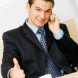 Cheerful businessman showing thumbs up — Stock Photo #5726821
