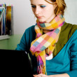Pretty young woman working at laptop — Stock Photo #5727296