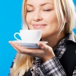 Young beautiful woman smelling coffee — Stock Photo #5730122