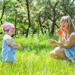 Mother with daughter outdoors — Stock Photo #6069379