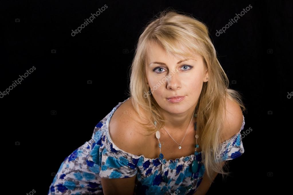 Young beautiful woman on a black background — Stock Photo #13485587