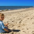 Child on a beach - Stock Photo