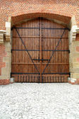 Massive wooden door — Stock Photo