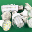 Stock Photo: Newest LED light bulb on green