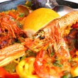 Spanish paella with seafood in a pan  — Stock Photo