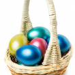 Multi-colored Easter eggs in basket with handle — Stock Photo #24070383
