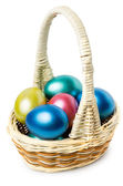 Multi-colored Easter eggs in basket with handle — Stock Photo