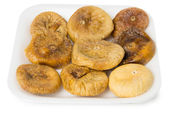 Heap of dried figs in polyfoam tray — Stock Photo
