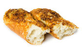 Broken baguette with cheese and garlic — Stock Photo