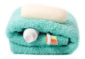 Toiletries (toothbrush, soap, towel) isolated on white backgroun — Stock Photo