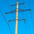 Tower of power transmission line on background of blue sky — Stock Photo