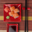 Portion of rolls with soy sauce, ginger, wasabi. Top view — Stock Photo #24552283